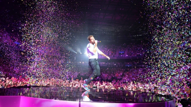 Chris Martin durant in concert cun la gruppa Coldplay