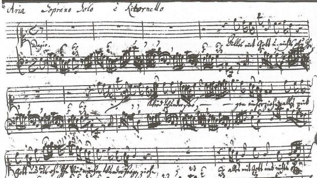 In manuscrit ord la plima da Johann Sebastian Bach.