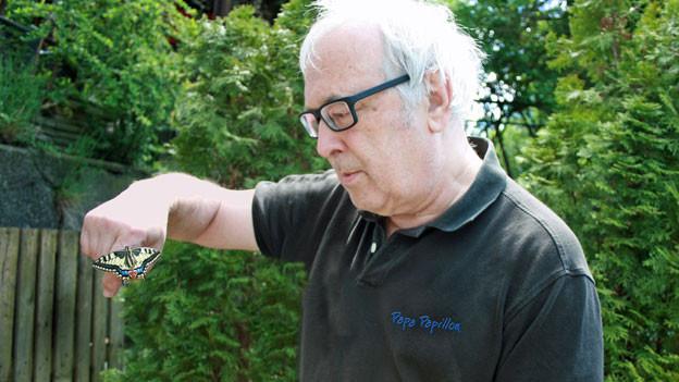 Marc de Roche mit einem Schwalbenschwanz.