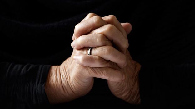 Muss ein Pfarrer zu einem personalen Gott beten?