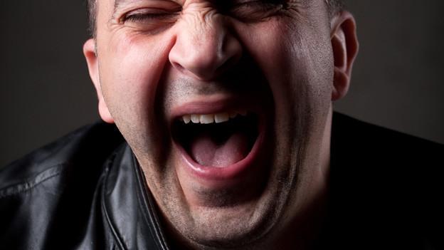 Symbolbild eines lachenden Mannes.