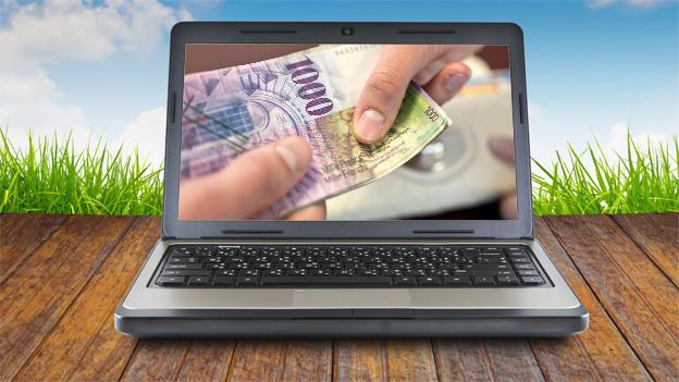 Laptop mit 1000-Franken-Note