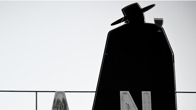 Schwarze Silhouette von Mann mit Hut