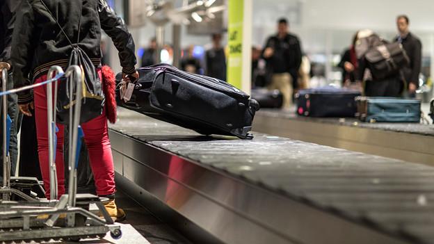 Kofferrückgabe am Flughafen.