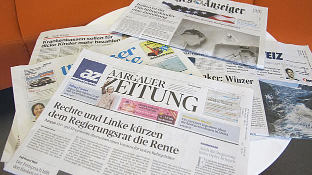 Schlechte Nachrichten in Zeitungen, Radio und Fernsehen können belastend sein.