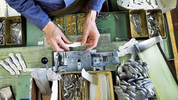 Hände und Werkzeug