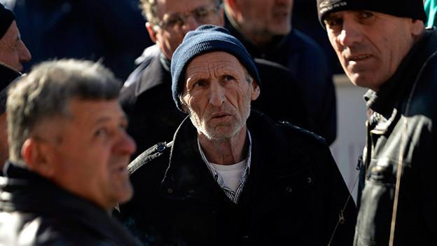Männer im Kosovo