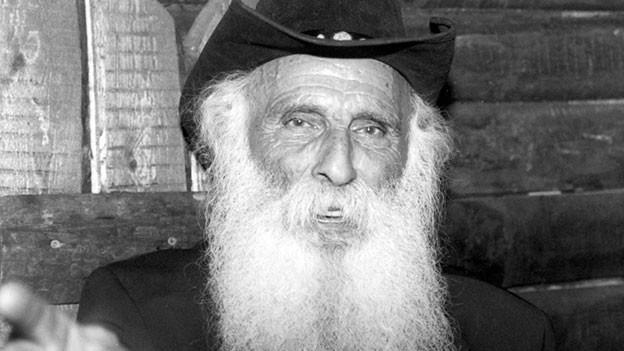 Alter Mann mit weissem Bart.
