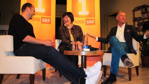 Daniel Humm, Irène Bodenmann-Meli und Daniel Fohrler auf der Bühne.
