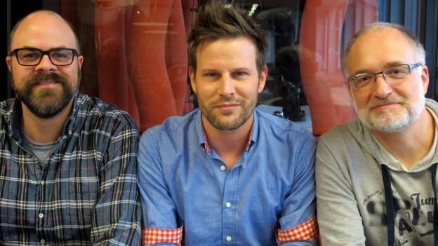 Sirio Flückiger, Rouven Born und Marcel Hähni zeigen ihren Bart.