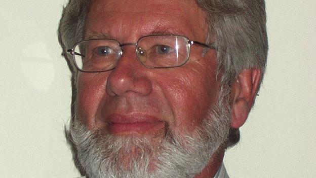 Markus Ruprecht mit Brille und grauem Haar.