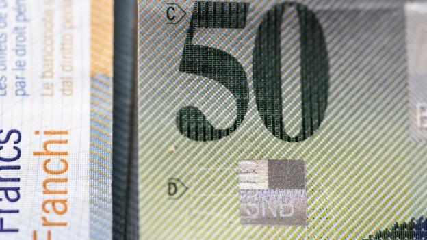Eine Schweizer 50 Franken Banknote in Nahaufnahme.