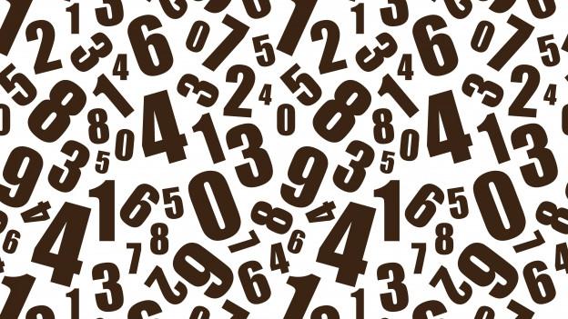 Schwarze Zahlen, wild durcheinander angeordnet.