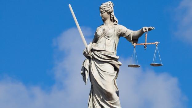Justitia Figur.