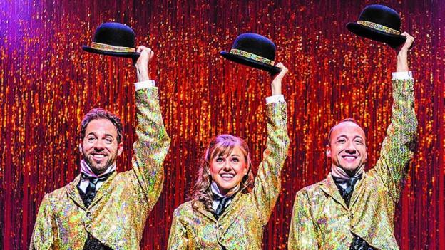 Die drei Hauptdarsteller in Gold