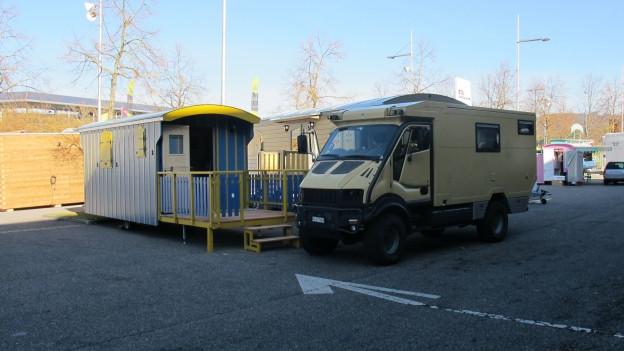 Das Bild zeigt einen Wohnwagen.