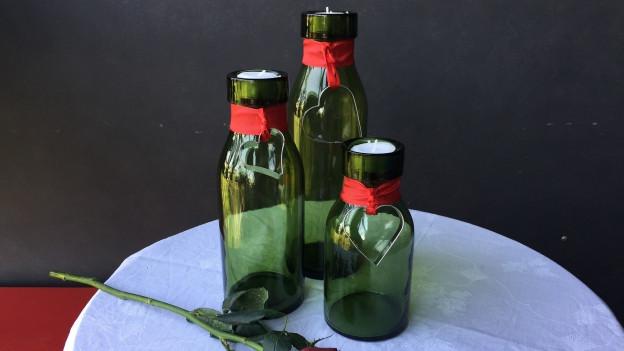 Grüne Bülach Gläser lassen sich perfekt umfunktionieren; in ein Kerzenlicht.