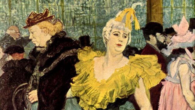 Eine jüngere Frau in gelbem Kostüm und eine ältere Frau in dunkler Kleidung.
