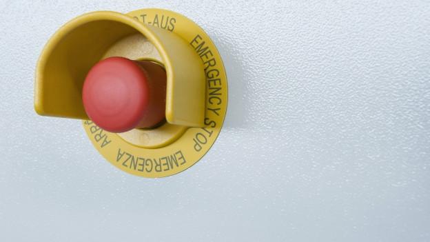 Der rote Knopf.