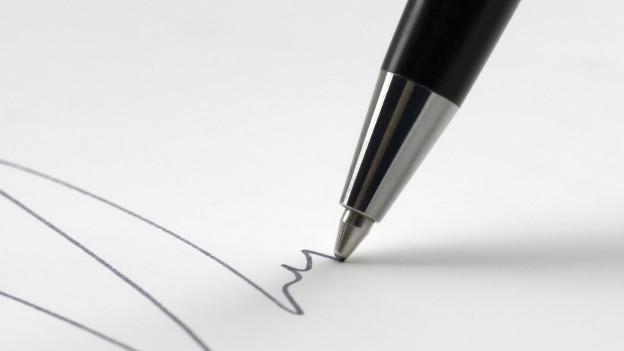 Ein Kugelschreiber und ein Schriftzug