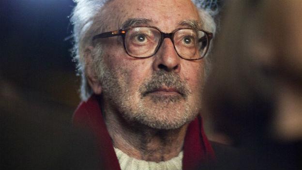 Jean-Luc Godard in einem Kino-Saal.