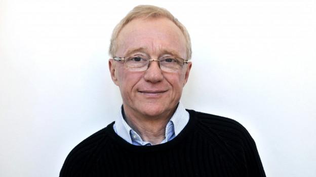 Portrait eines älteren Mannes mit Brille.