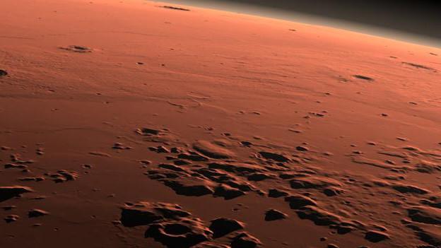 Am Computer generiertes Bild des roten Planeten zwischen Tag und Nacht.