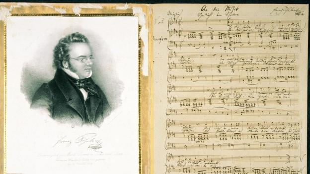 Porträt von Schubert, daneben ein Notenblatt