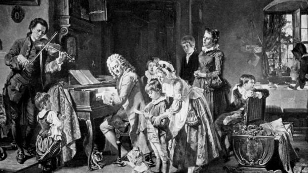 Gemälde, das J.S. Bach beim Klavierspielen mit seiner Familie zeigt.
