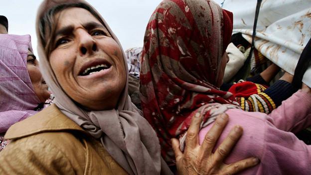Wenig Hoffnung auf Frieden: Syrische Frau in einem Flüchtlingslager.