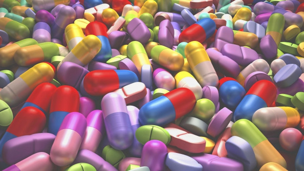 Grafik von bunten Pillen und Tabletten