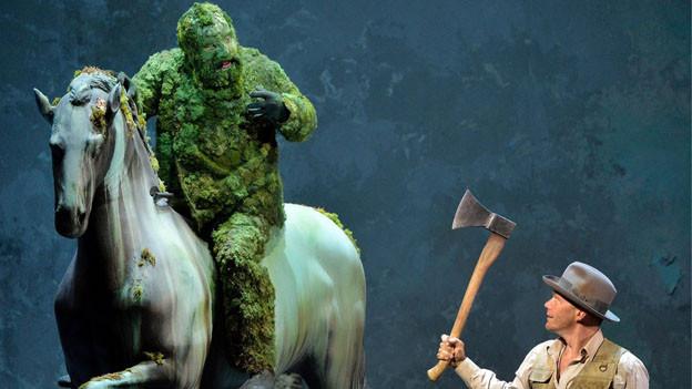 Gawain soll dem grünen Ritter den Kopf abschlagen.