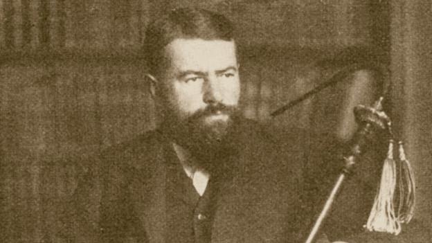 Das Bild zeigt Max Weber, einen bärtigen Mann in Anzug.