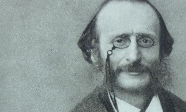 Das Bild zeigt das Porträt eines Mannes mit Brille und Backenbart, alt anmutend.