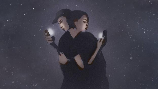 Ein Paar umarmt sich und ist abgelenkt von ihren Smartphones