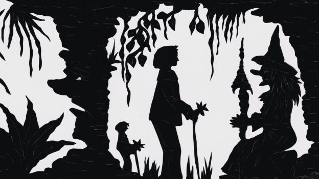 Sihouette einer Person mit einem Stock in der Hand, die vor einer Hexe steht.