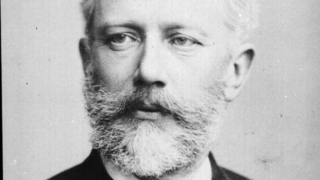 Ein Mann mit grauem Bart