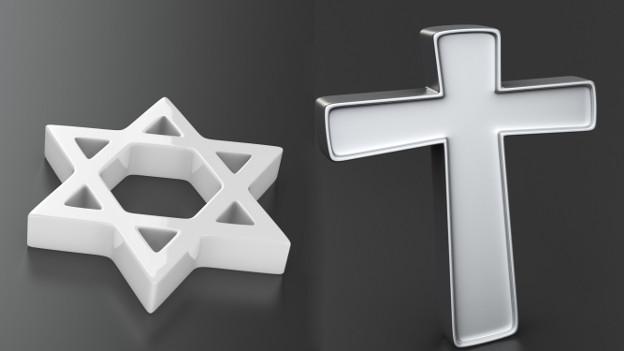 Ein Davidsstern und ein Kreuz