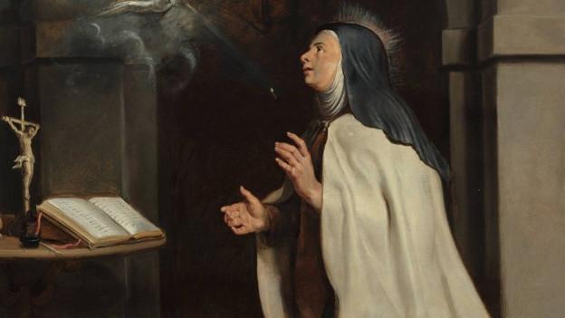 Ein Gemälde einer Nonne vor einem Gebetbuch, die zu einem Lichtstrahl blickt