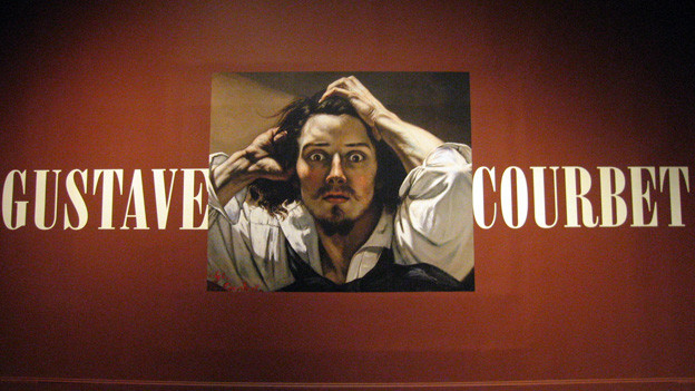 Das Porträt des Malers Gustave Courbet bei einer Ausstellung.
