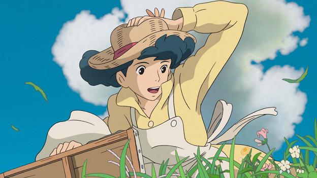 Szene aus einem Animationsfilm: Eine Frau sitzt in einer Wiese
