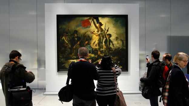 «La Liberte Guidant le Peuple» von  Eugene Delacroix ist im Louvre zu bewundern.