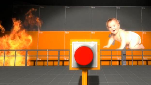 Nur wer vier Stunden lang den roten Knopf drückt, schützt das herzige Baby vor dem Flammentod.