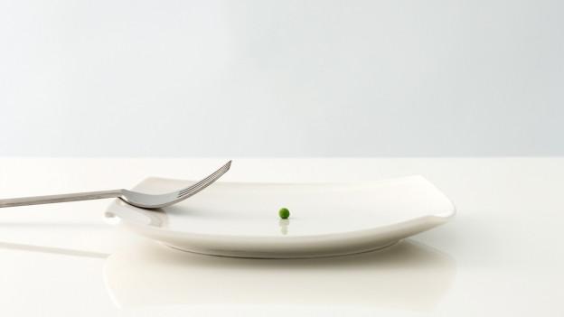 Ein Teller mit einer Erbse