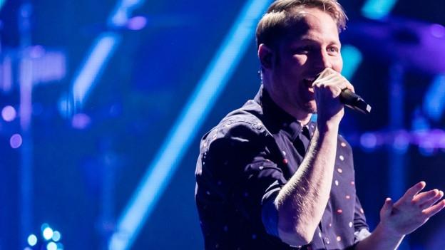 Stefan Buck, Sänger von Hecht, auf der Bühne