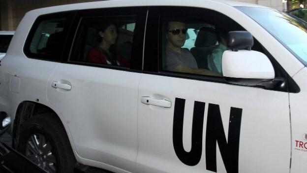 UN-Chemiewaffenexperten bei ihrer Ankunft in Damaskus.