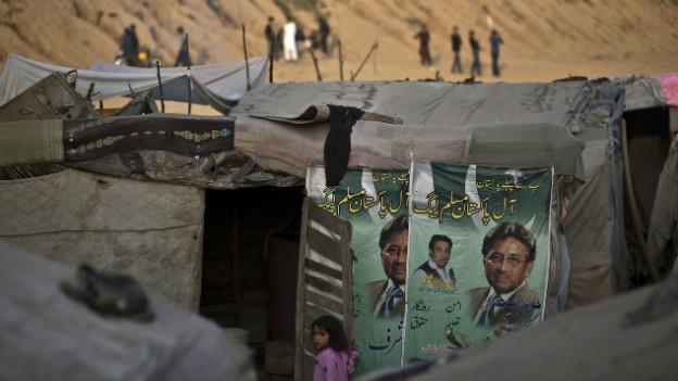 Pervez Musharraff-Plakat an der Wand einer Hütte in Rawalpindi.