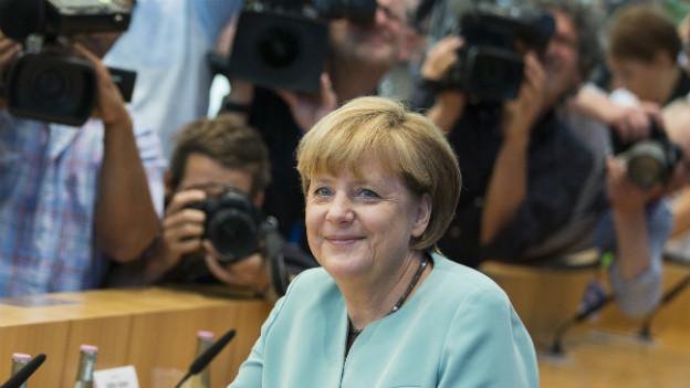 Merkel bei ihrem letztem Presseauftritt vor den Ferien.