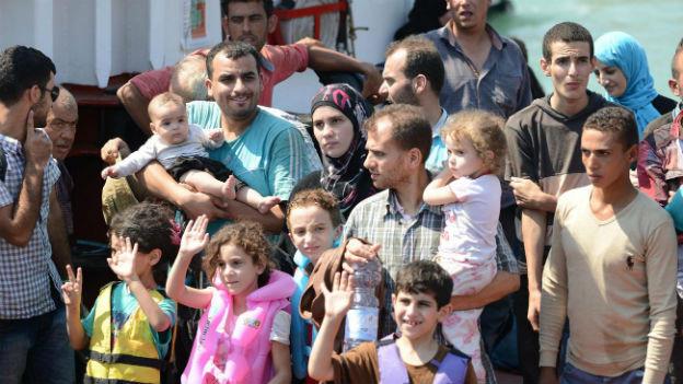 Eine Flüchtlingsgruppe nach ihrer Ankunft in Catania am 19. August 2013