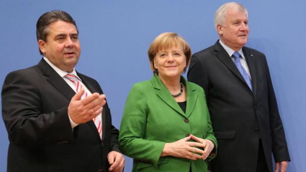 SPD-Chef Gabriel, CDU-Kanzlerin Merkel und CSU-Chef Seehofer präsentieren die Einigung.